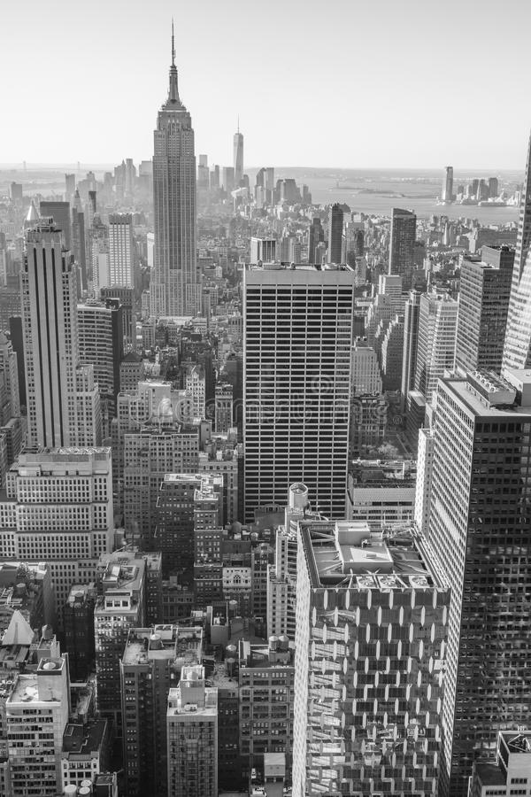 New York City, Manhattan downtown skyline, black and white. USA, New York City, Manhattan downtown skyline with illuminated Empire State Building and skyscrapers stock photos