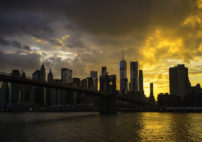New York City Manhattan downtown skyline and Brooklyn bridge stock photo