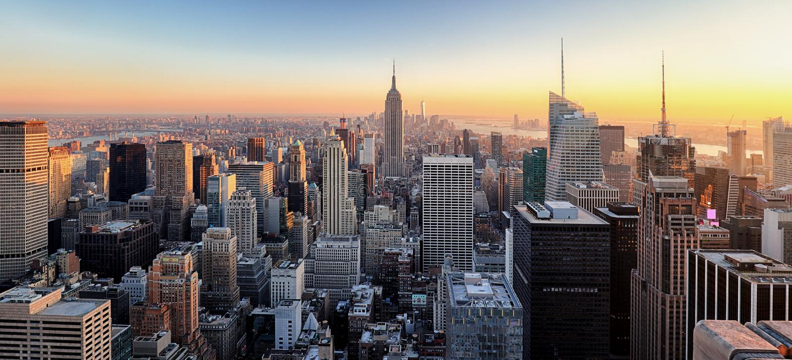 New York City. Manhattan downtown skyline with illuminated Empire State Building and skyscrapers at sunset. royalty free stock photos