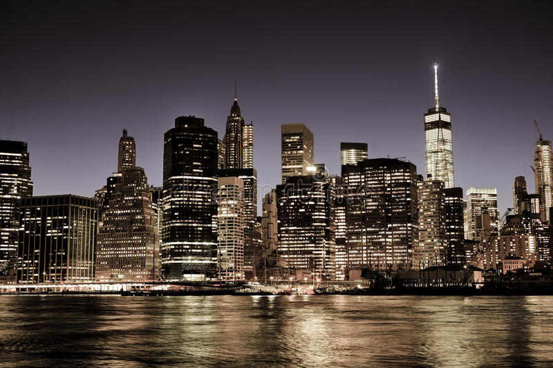 New York City Manhattan downtown skyline at night. With illuminated skyscrapers, vintage filter stock photos