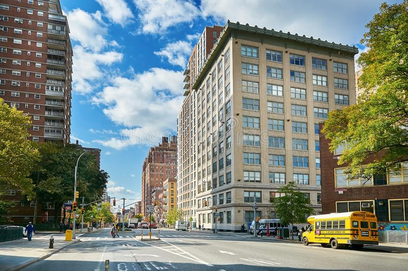 NEW YORK CITY, MANHATTAN, OCT,25, 2013: View on NYC wide street, road with yellow school bus. NYC traditional architecture royalty free stock photos