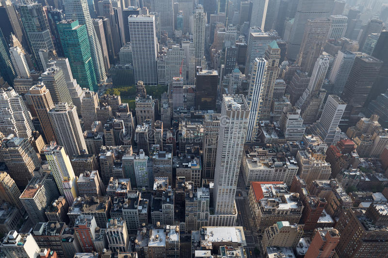 New York City Manhattan skyline aerial view with skyscrapers. Roof tops and streets in a sunny day royalty free stock photography