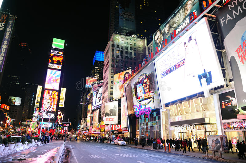 New York City Manhattan Time Square night. NEW YORK CITY, NY - JAN 30: Times Square is featured with Broadway Theaters and LED signs as a symbol of New York City royalty free stock photos
