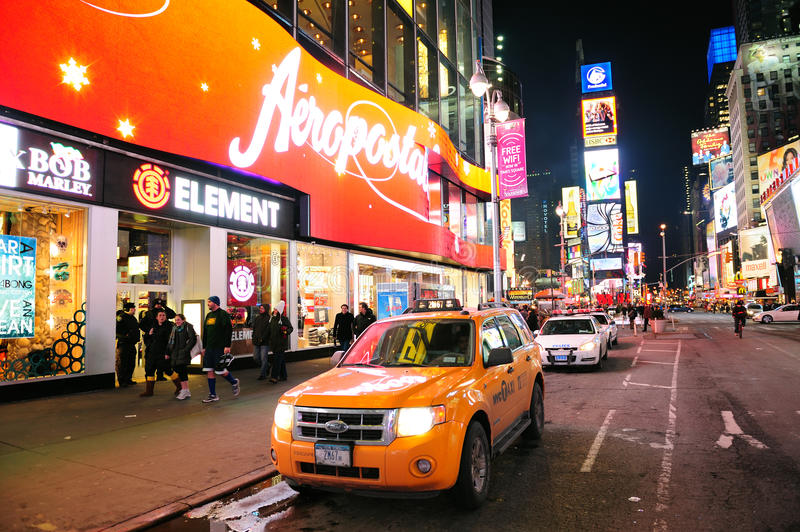 New York City Manhattan Time Square night. NEW YORK CITY, NY - JAN 30: Times Square is featured with Broadway Theaters and LED signs as a symbol of New York City royalty free stock images