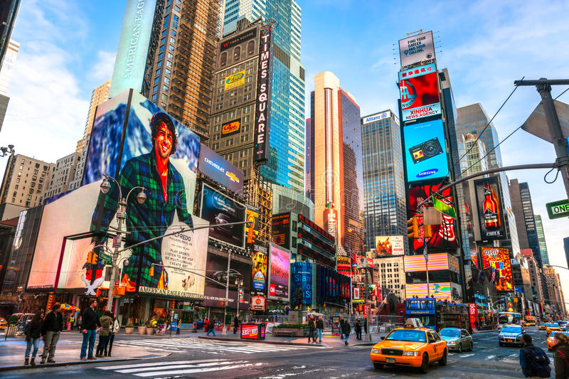 NEW YORK CITY -MARCH 25: Times Square, featured with Broadway Th. NEW YORK CITY - DEC 01 Times Square ,is a busy tourist intersection of neon art and commerce royalty free stock image