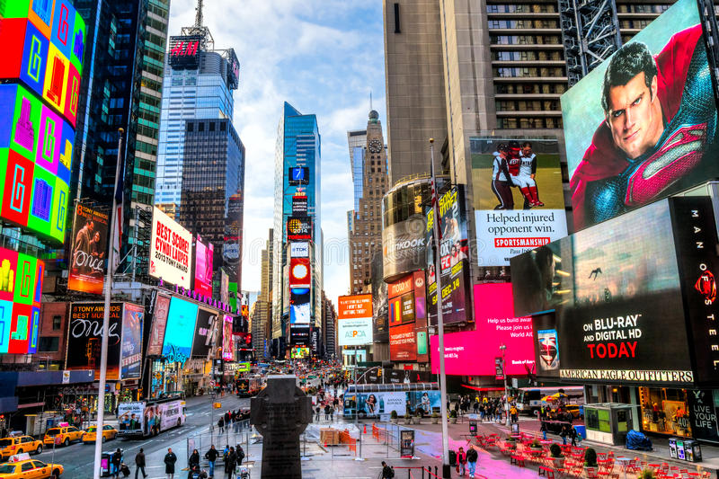 NEW YORK CITY -MARCH 25: Times Square, featured with Broadway Th. NEW YORK CITY - DEC 01 Times Square ,is a busy tourist intersection of neon art and commerce stock image