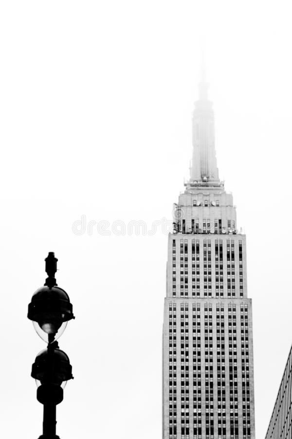 Empire State Building in fog stock images