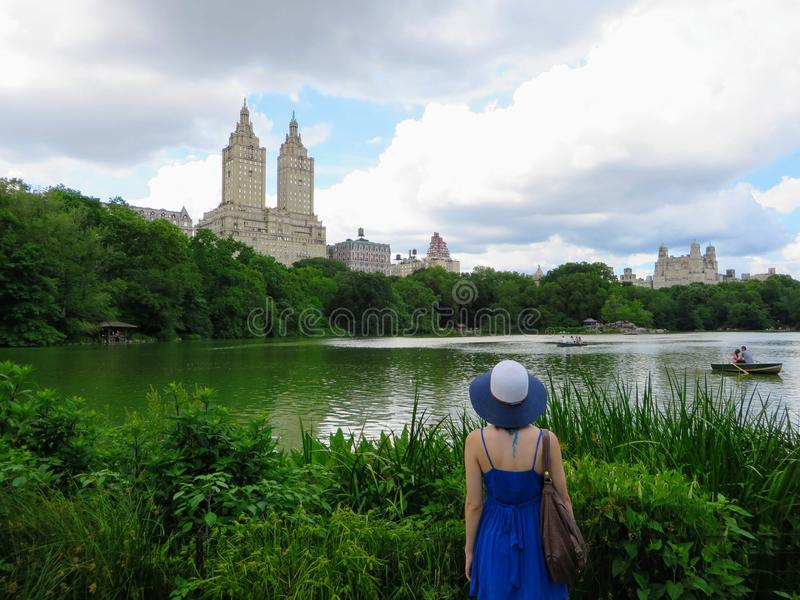 New York City, New York, United States - June 26th, 2014: A young well dressed tourist admires Central Park and the surrounding J royalty free stock image