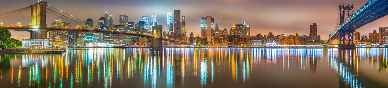New York City at night, Brooklyn and Manhattan Bridges royalty free stock images