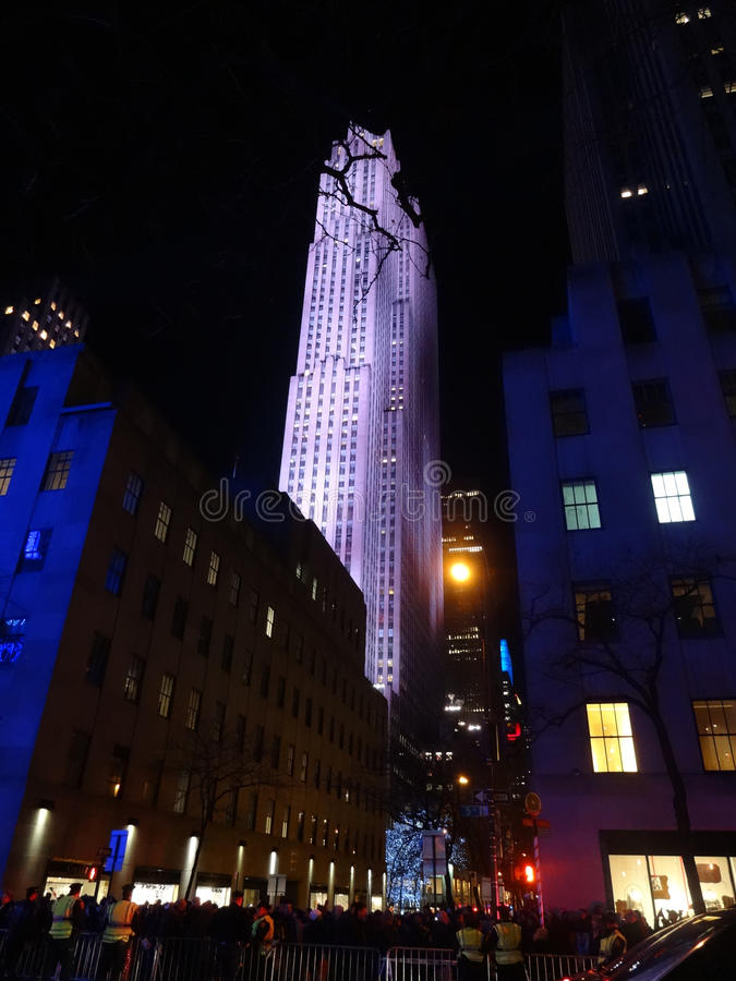 New York City at Night. Looking up at Rockefeller Center in New York City. The NYPD manages pedestrian traffic at street level during the holidays stock photography