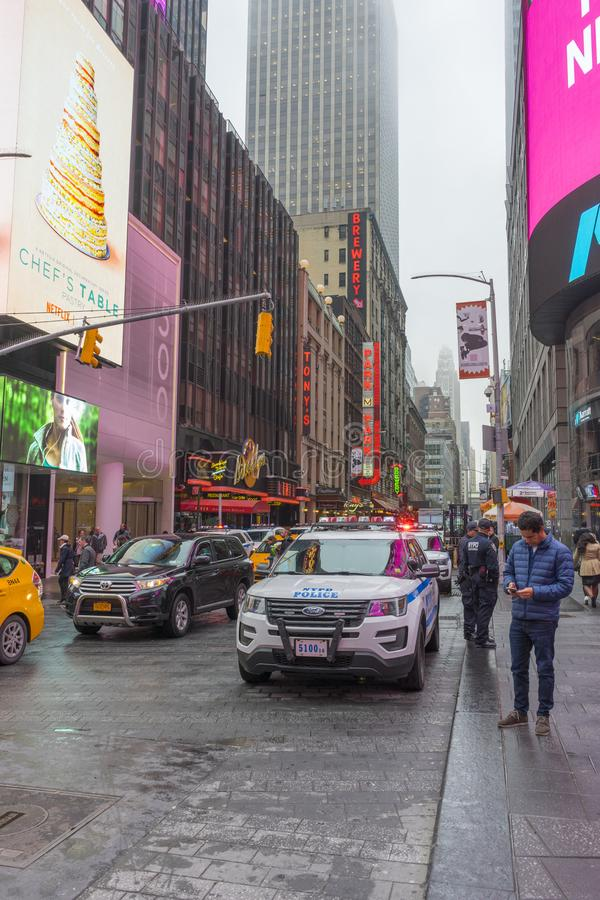 Crowded of tourist walking in Times Square with LED signs. NEW YORK CITY, NY - APRIL 26,2018 : Crowded of tourist walking in Times Square with LED signs on stock images