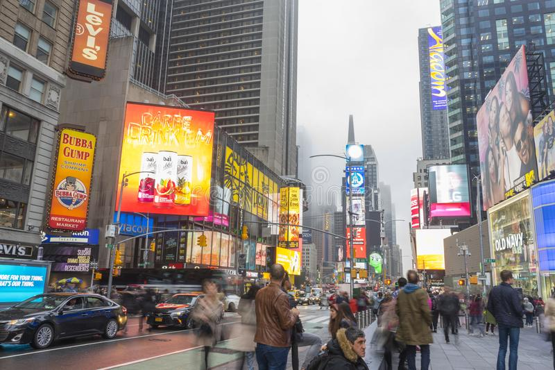 Crowded of tourist walking in Times Square with LED signs. NEW YORK CITY, NY - APRIL 26,2018 : Crowded of tourist walking in Times Square with LED signs on stock photos