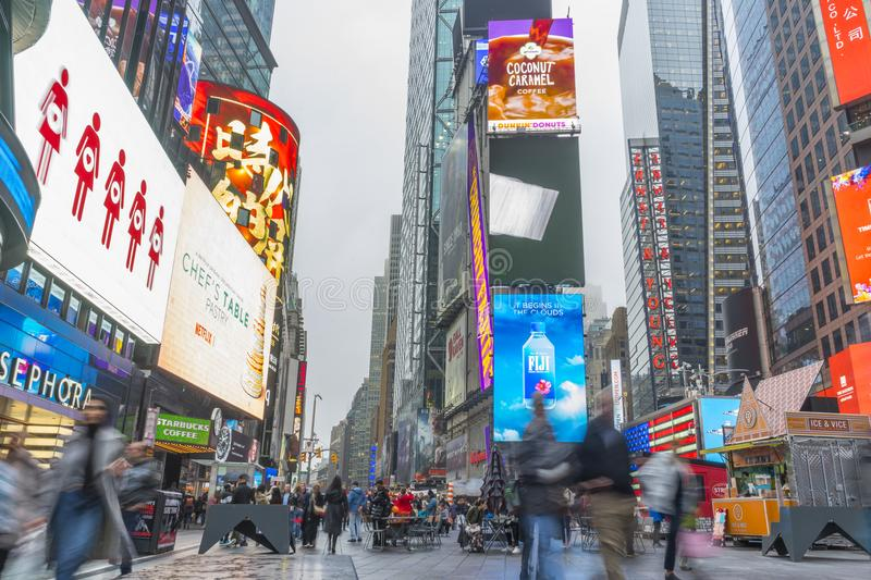 Crowded of tourist walking in Times Square with LED signs stock photo