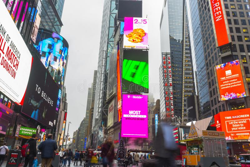 Crowded of tourist walking in Times Square with LED signs. NEW YORK CITY, NY - APRIL 26,2018 : Crowded of tourist walking in Times Square with LED signs on royalty free stock photos