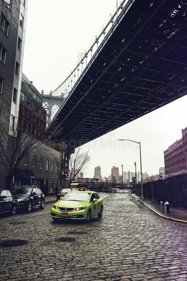 Manhattan bridge view from Brooklyn Dumbo neighbourhood. NEW YORK CITY,NY - APRIL 25,2018 : Manhattan bridge view from Brooklyn Dumbo neighbourhood. Manhattan stock photos