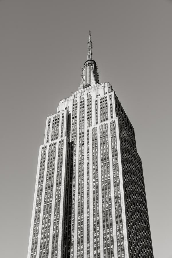 Black & White low angle vertical view of the Art Deco Empire State Building skyscraper located in Midtown Manhattan, New York City stock images