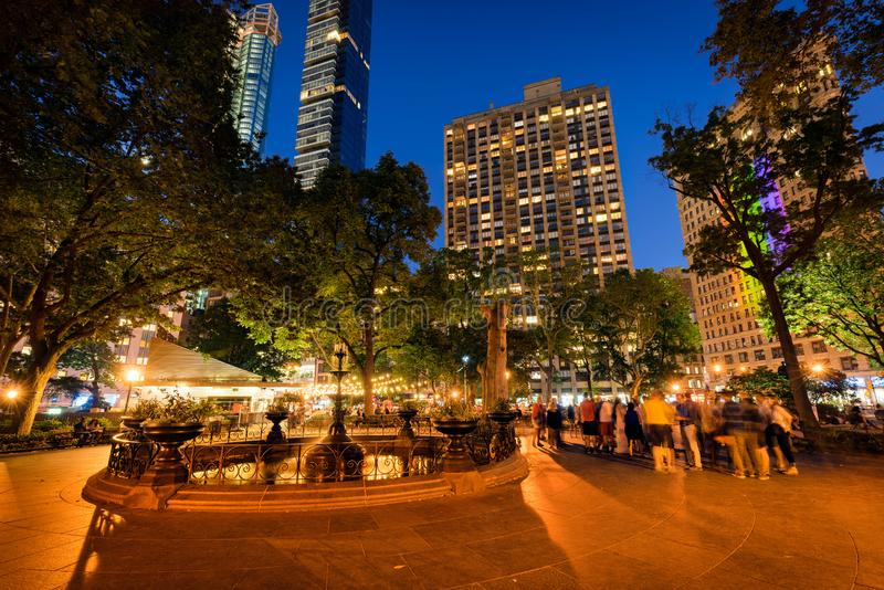 Madison Square Park and fountain at twilight in Summer. Flatiron District, Midtown, Manhattan, New York City royalty free stock photo