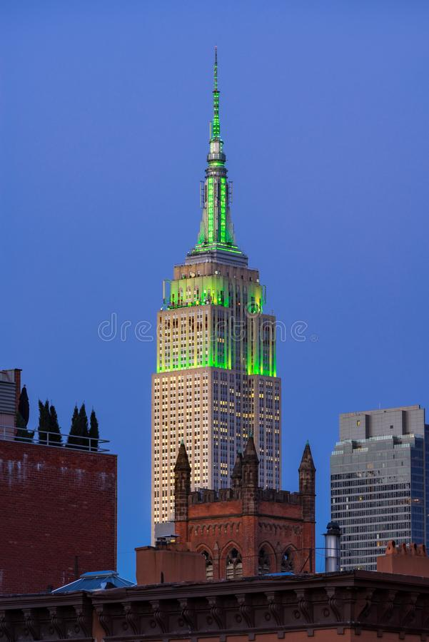 The Empire State Building at twilight illuminated in green light. New York City stock photography