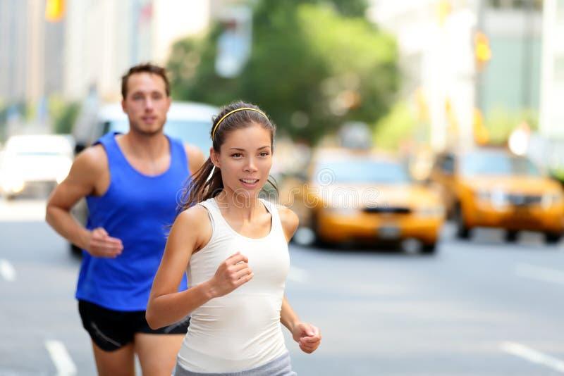 New York City NYC runners - urban people running stock photography