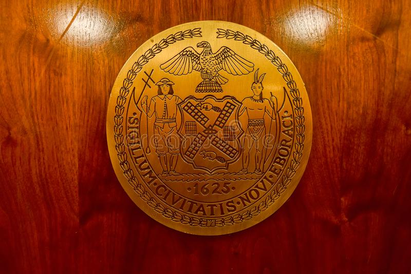 Seal of the City of New York. New York City - Oct 14, 2017: The seal of the New York City, adopted in an earlier form in 1686, bears the legend Sigillum royalty free stock photo