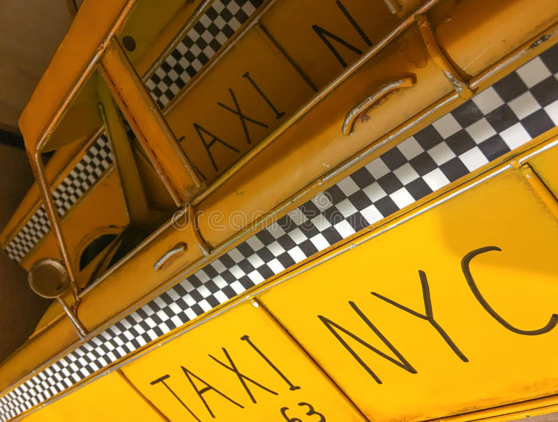 NEW YORK CITY - OCTOBER 2015: Old chequered taxi sign. This is t royalty free stock photo