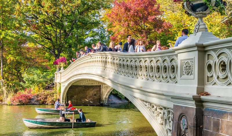 NEW YORK CITY - OCTOBER 2015: People enjoy Central Park in foliage season. New York attracts 50 million tourists worldwide annual royalty free stock photo