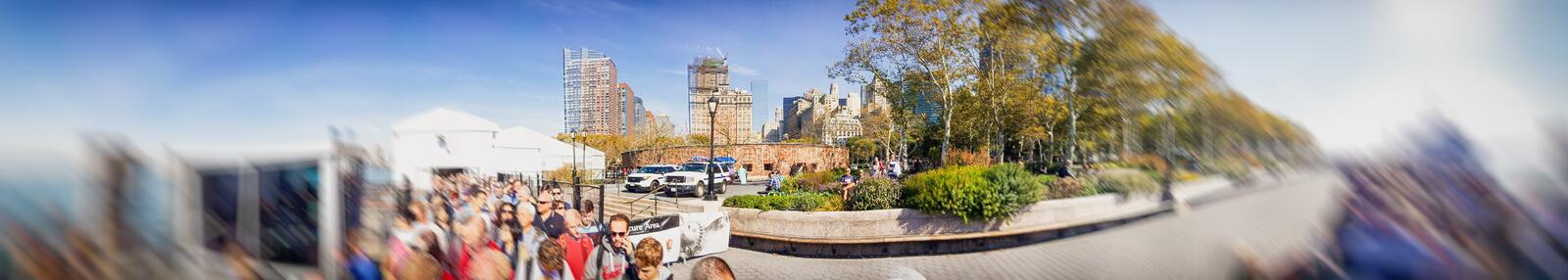 NEW YORK CITY - OCTOBER 2015: Tourists in line for Liberty Island Ferry. New York attracts 50 million tourists annually.  royalty free stock photos