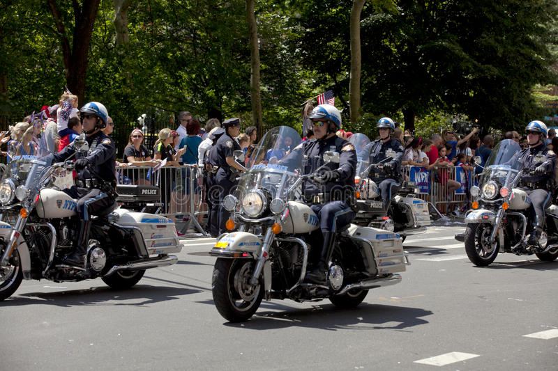New York City Police Department Motorcycle Squad. Members of the New York City Police Department Motorcycle squad drive up Broadway's Canyon of Heroes during the royalty free stock images