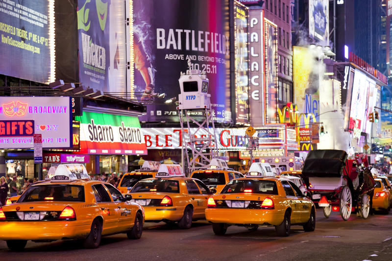 NEW YORK CITY - SEPT 5: Times Square. Featured with Broadway Theaters, Taxi Cabs and animated LED signs, is a symbol of New York City and the United States stock image