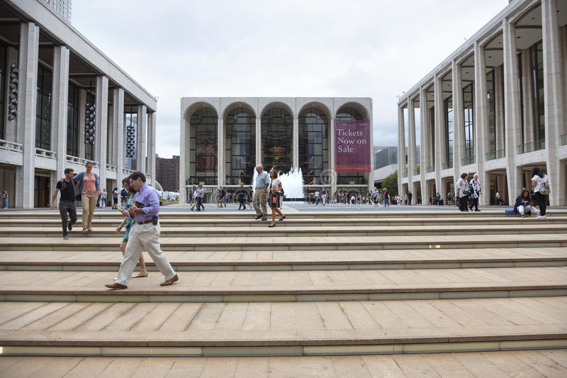 new york city, 12 september 2015: people walk on steps near metropolitan opera at lincoln centre in new york city royalty free stock photo