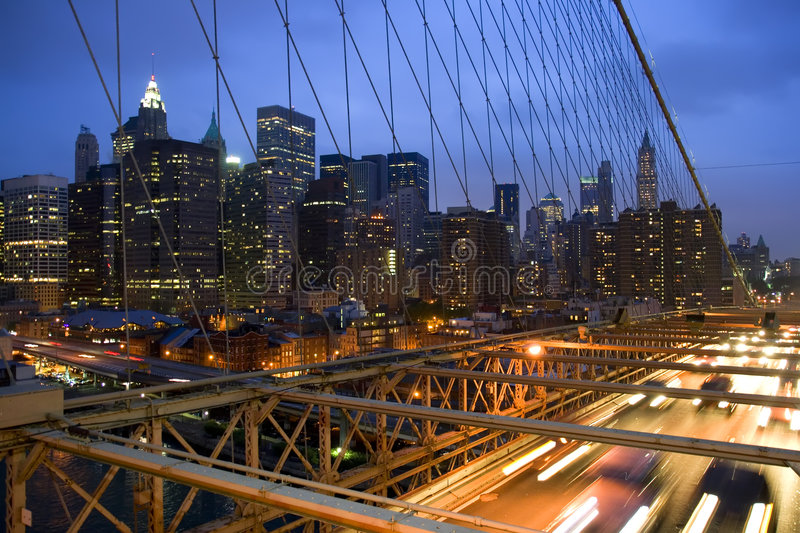 New York City Skyline. View of New York City skyline through Brooklyn Bridge latticework royalty free stock photos