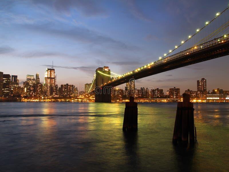 New York City Skyline and brooklyn bridge. At dusk royalty free stock photos