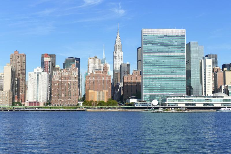 New York City Skyline, East River and Manhattan, New York waterfront on sunny day with blue sky in background stock image
