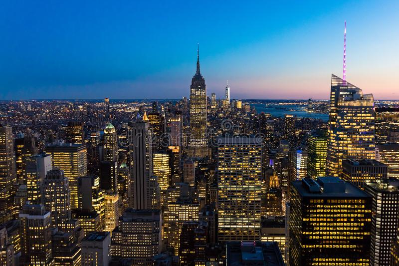 New York City Skyline in Manhattan downtown with Empire State Building and skyscrapers at night USA. New York City Skyline in Manhattan downtown with Empire royalty free stock photo