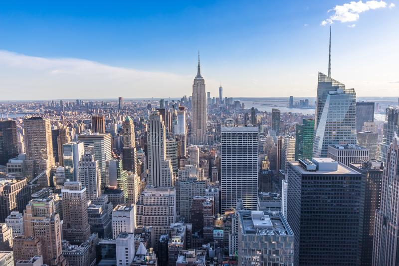 New York City Skyline in Manhattan downtown with Empire State Building and skyscrapers on sunny day with clear blue sky USA royalty free stock image