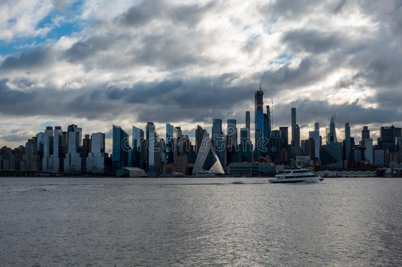 New York City Skyline Morning Sun Triangular building. A Ferry crossing across stock photography