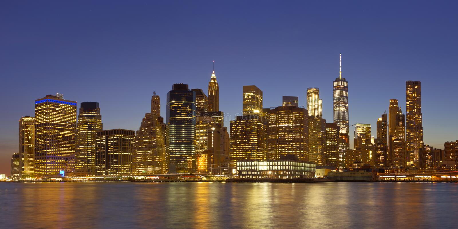 The New York City skyline at night stock images
