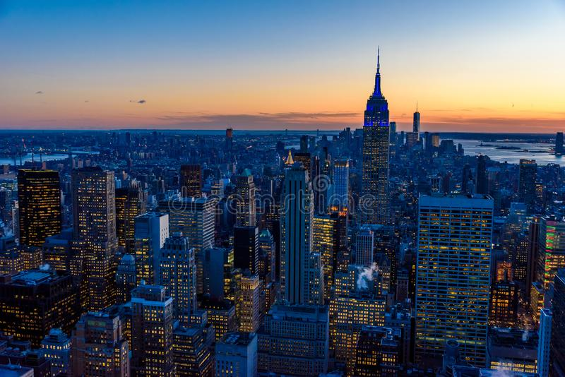 New York City skyline at night - skyscrapers of midtown Manhattan with Empire State Building at Amazing Sunset - USA royalty free stock images