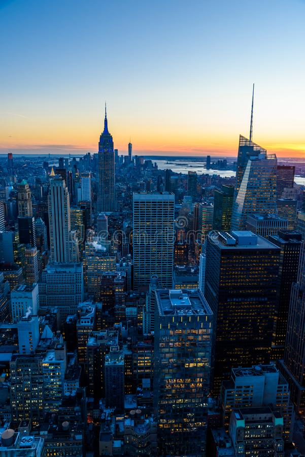 New York City skyline at night - skyscrapers of midtown Manhattan with Empire State Building at Amazing Sunset - USA stock image