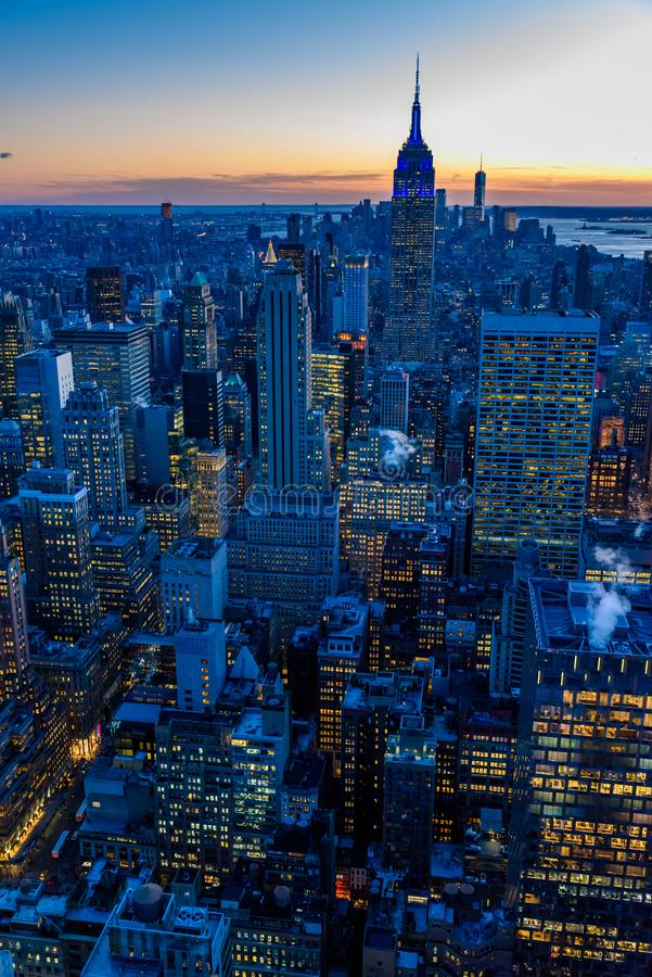 New York City skyline at night - skyscrapers of midtown Manhattan with Empire State Building at Amazing Sunset - USA royalty free stock photos