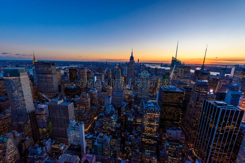 New York City skyline at night - skyscrapers of midtown Manhattan with Empire State Building at Amazing Sunset - USA royalty free stock photo