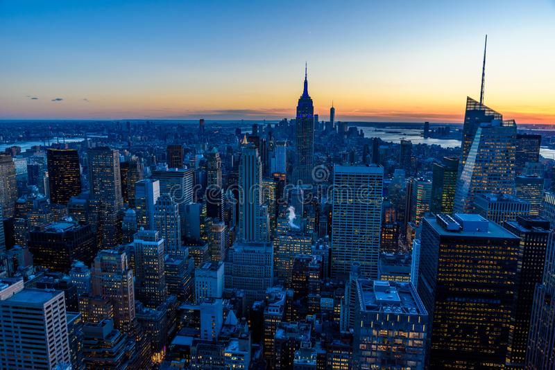 New York City skyline at night - skyscrapers of midtown Manhattan with Empire State Building at Amazing Sunset - USA royalty free stock image