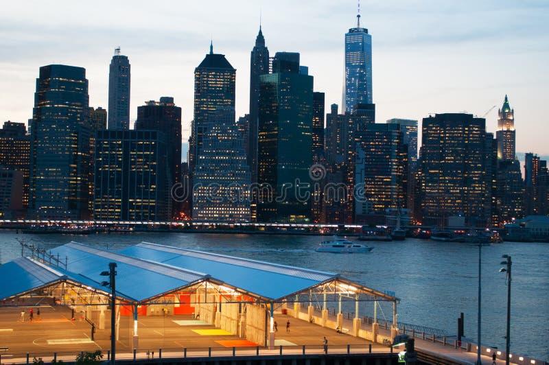 New York City skyline seen from Brooklyn Heights Promenade after sunset, lights. New York City, Nyc, the Big Apple, Manhattan, New York Bay, Hudson River stock image