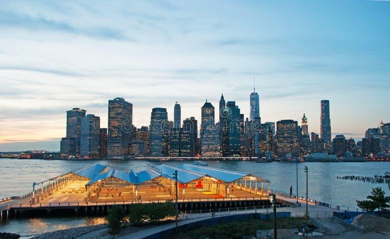 New York City skyline seen from Brooklyn Heights Promenade after sunset, lights. New York City, Nyc, the Big Apple, Manhattan, New York Bay, Hudson River stock photography
