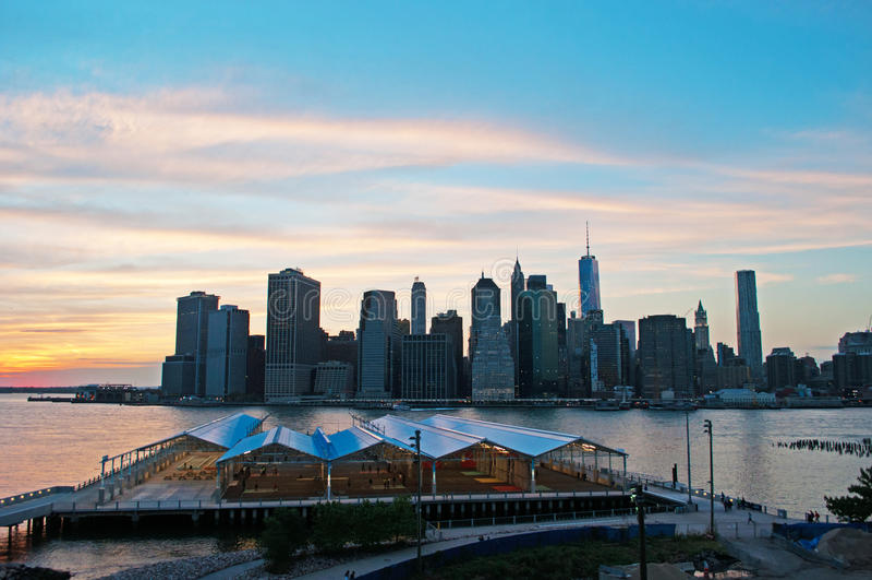New York City skyline seen from Brooklyn Heights Promenade at sunset. New York City, Nyc, the Big Apple, Manhattan, New York Bay, Hudson River, Atlantic Ocean royalty free stock image