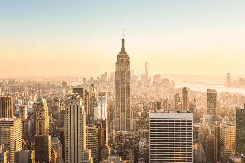 New York City skyline with urban skyscrapers at sunset, USA. stock photos