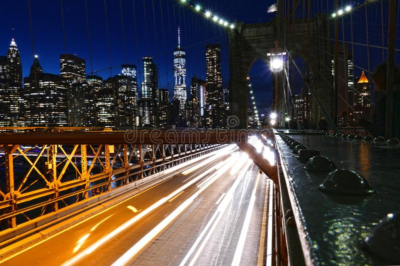 New York City skyline view from the Brooklyn Bridge at night, Manhattan buildings and skyscrapers stock photo