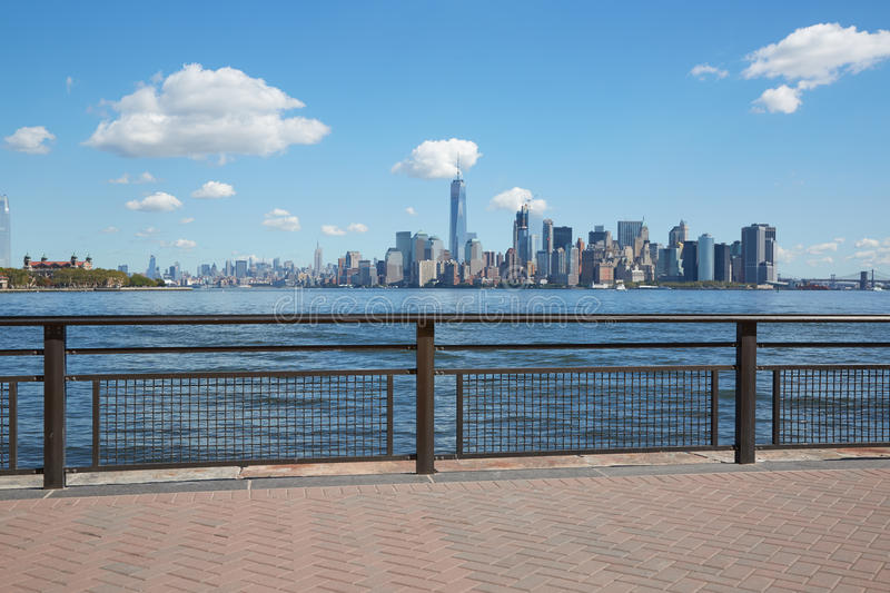 New York city skyline view from empty dock with railing stock images