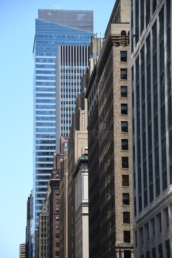New York City skyscraper in Midtown Manhattan. On a sunny day with trees and a blue sky stock photo