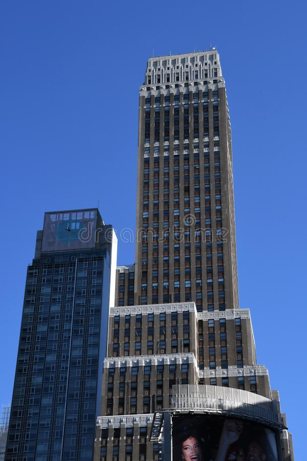 New York City skyscraper in Midtown Manhattan. On a sunny day with trees and a blue sky stock images